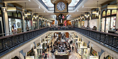 People shop and dine at cafes inside the Queen Victoria Building in Sydney, Saturday, October 16, 2021. After 106 days, almost 63,000 cases and nearly 440 deaths, stay-at-home orders were lifted and a raft of restrictions eased across NSW on Monda...