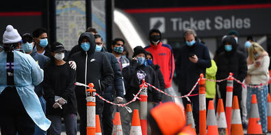 People are seen waiting in line at a pop-up Covid19 testing facility outside of the LaCrosse apartment block in Docklands, Melbourne, Sunday, July 25, 2021.  The LaCrosse Building at in Docklands has been listed as a tier 2 exposure site for all d...