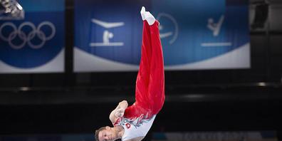 Christian Baumann strebt an den Weltmeisterschaften in Japan an seinem Spezialgerät Barren die Final-Teilnahme an