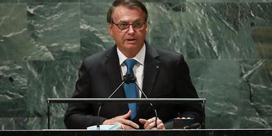 Jair Bolsonaro, Präsident von Brasilien, sorgt mit Aussagen über sein Vorgehen gegen die Corona-Pandemie für Verwunderung. Foto: Eduardo Munoz/Pool Reuters/AP/dpa