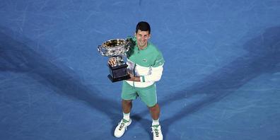 Gibt es dieses Bild auch 2022? Noch ist nicht klar, ob Novak Djokovic überhaupt zur Titelverteidigung antritt.