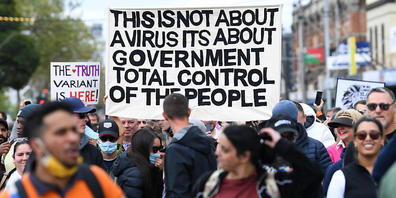 """Protesters gather during a 'The Worldwide Rally for Freedom' in Melbourne, Saturday, September 18, 2021. The Worldwide Rally for Freedom is a purported day of rallies for """"freedom"""" across many countries, which is also labelled 'World Wide Demonstr..."""