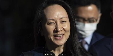 Meng Wanzhou, Finanzchefin von Huawei, lächelt, als sie ihr Haus in Vancouver verlässt. Foto: Darryl Dyck/CP/AP/dpa