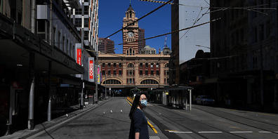 A person wearing a face mask is seen in Melbourne, Wednesday, October 20, 2021. Victoria will end its sixth long-running lockdown on Thursday, five days earlier than planned, as the state races to its 70 per cent fully vaccinated target. (AAP Imag...
